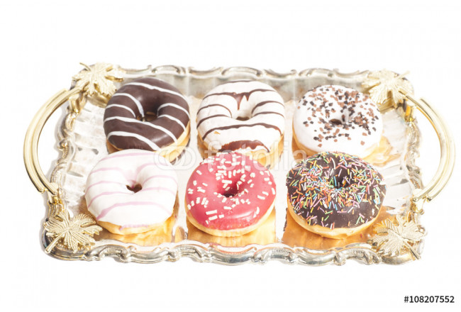 Group of doughnuts on the tray on white background 64239