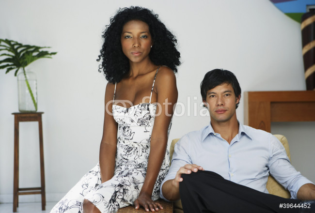 South American couple sitting on chair 64239