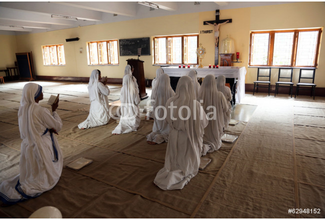 Missionaries of Charity in prayer in Mother House, Kolkata 64239