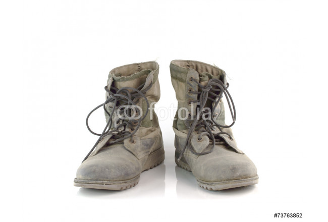 Old combat boots isolated on white background 64239