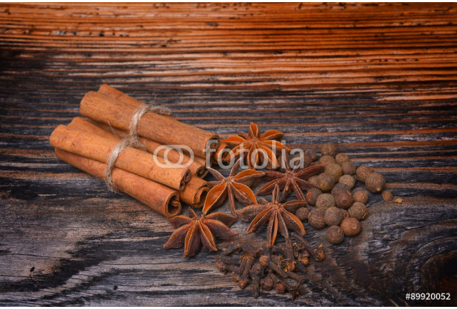 Spices lying on a wooden surface 64239