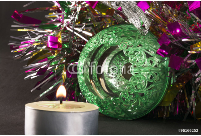 Big green carved mirror ball with a candle and tinsel 64239