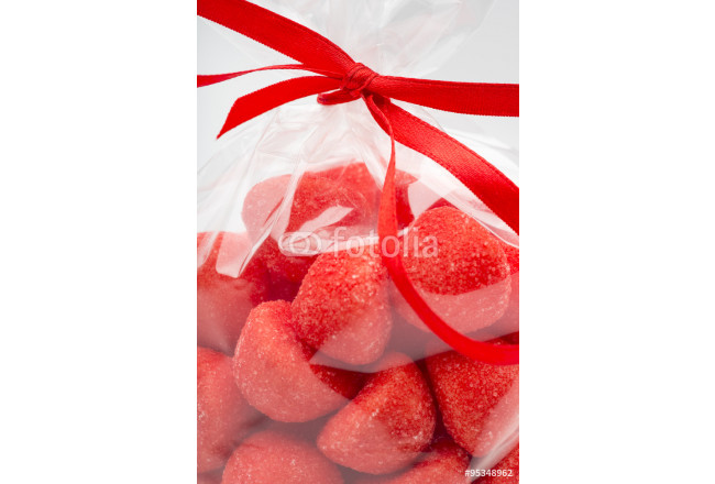 Closeup on luxury bag of candy strawberries with red ribbon 64239