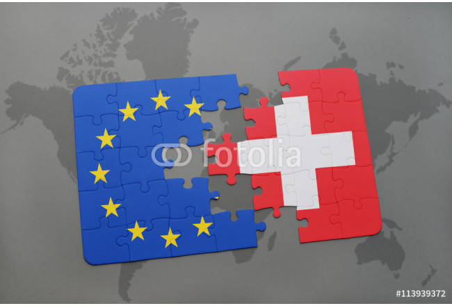 puzzle with the national flag of switzerland and european union on a world map background. 64239