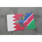 puzzle with the national flag of bahrain and namibia on a world map background. 64239