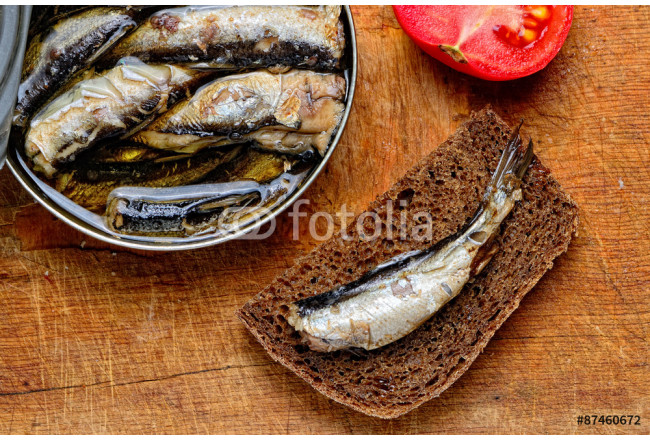 sandwich with sprats, sliced tomatoes and a can of sprats on an 64239