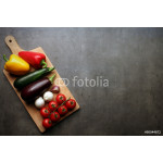 Ratatouille vegetables on wooden cutting board with space for recipe text 64239