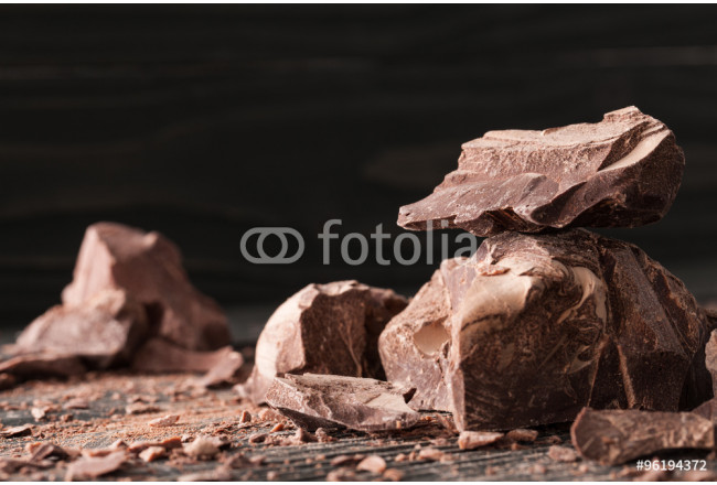 Chocolate pieces on a dark backround 64239