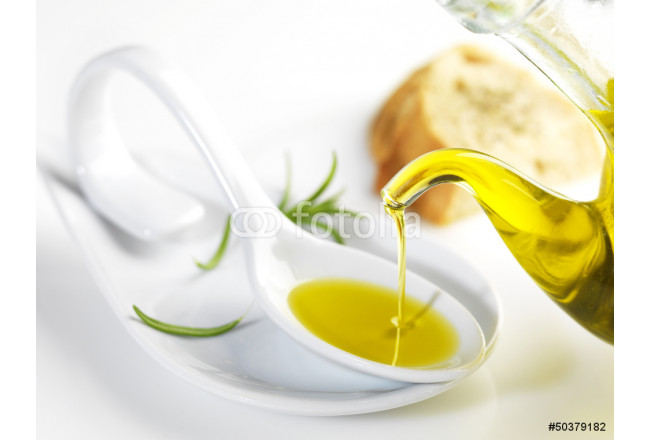virgin olive oil pouring in a spoon 64239