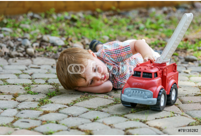 Boy Playing with a Toy Fire Truck 64239