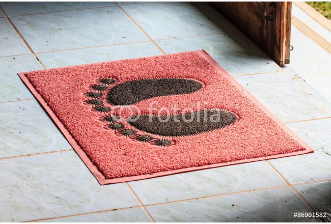 foot on floor mat with 64239
