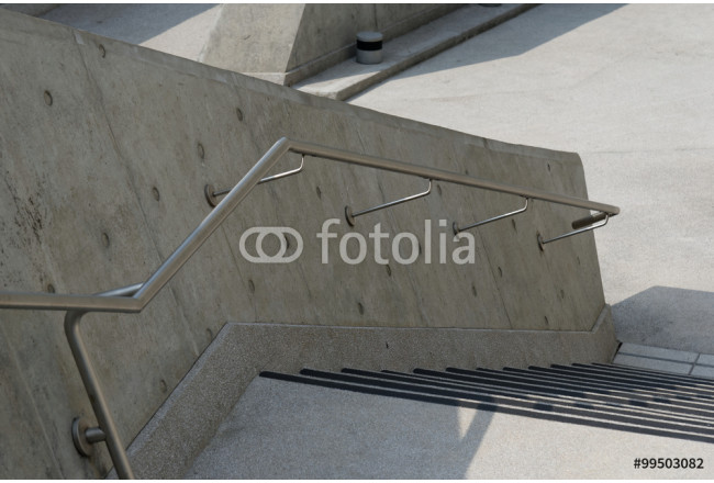 metal handrail on a concrete wall 64239