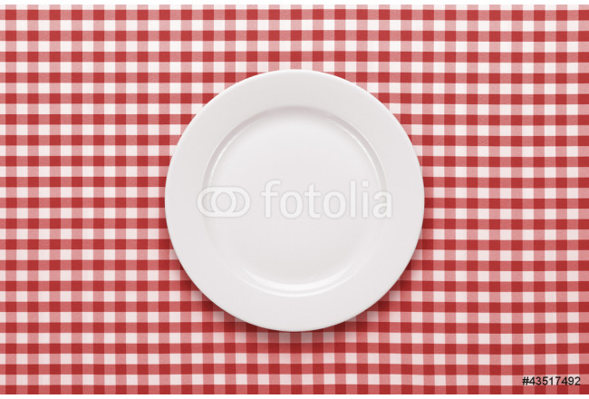Empty plate at classic checkered tablecloth 64239