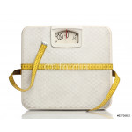 Weight scale with a measuring tape over white 64239