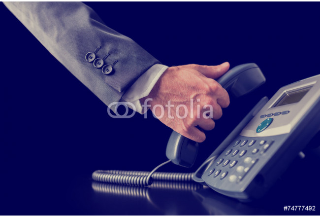 Retro image of businessman making a phone call 64239