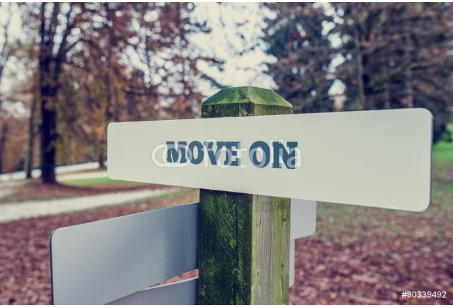Move on concept with a rural signboard in an autumn landscape 64239