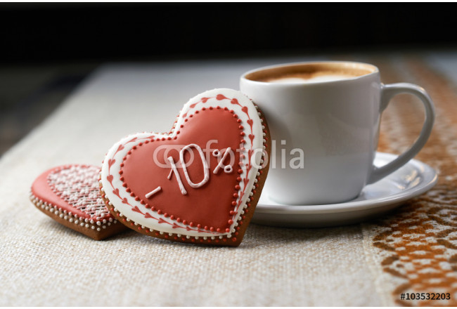Tasty celebration. Discount decorated heart shaped cookie and a cup of coffee at the local coffee shop 64239