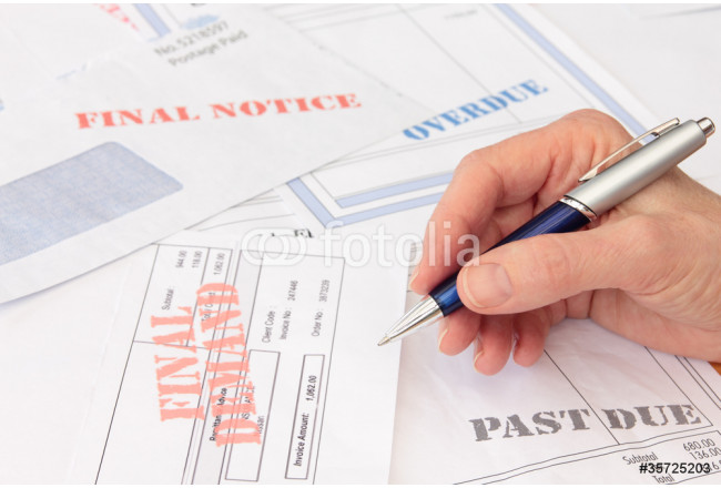Overdue Bills and Invoices with Pen in Hand 64239