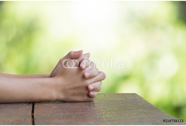 Hands on an old wooden table Natural background blurred bokeh pretty bright. Prayer to God 64239
