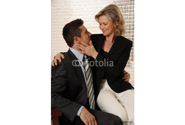 Man and woman sitting in hotel lobby 64239