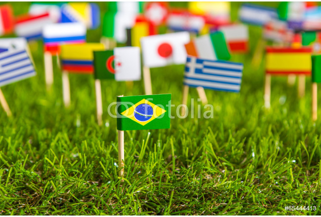 Paper cut of flags on grass for Soccer championship 2014 64239