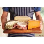 Grocer Holding Board With Selection Of Luxury Cheeses 64239