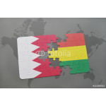 puzzle with the national flag of bahrain and bolivia on a world map background. 64239