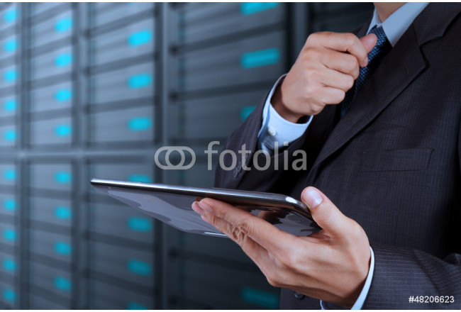 businessman hand using tablet computer and server room 64239