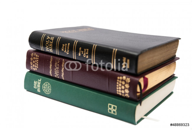 Stack of three Holy Bibles 64239