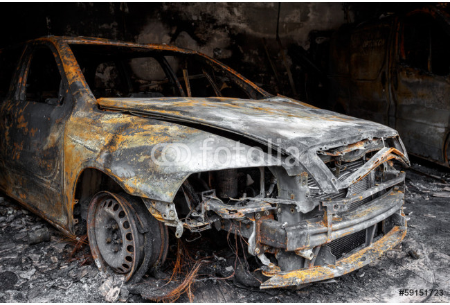 Close up photo of a burned out car 64239