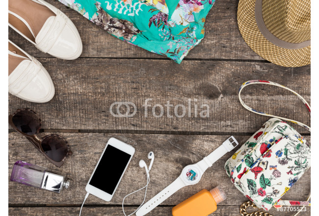 Woman summer clothes and accessories on old wooden background 64239