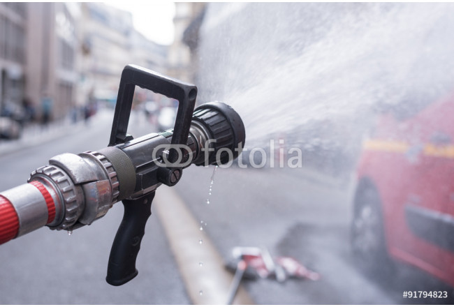 Water jet splashing from a fire fighting firehose nozzle 64239