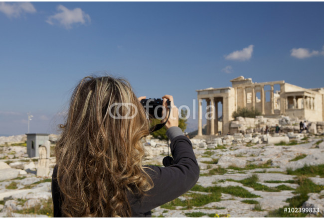 Woman  taking picture of Ancient Ruin . 64239