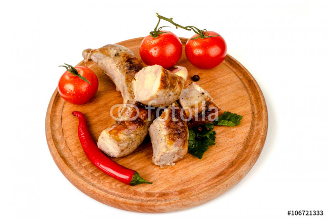 fried pork sausages on a barbecue on a wooden plate with cherry tomatoes and hot peppers 64239