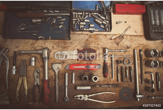 Tools on wooden plank 64239