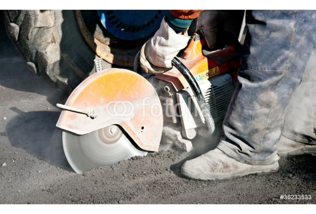 Cutting road works with petrol driven angle grinder 64239