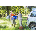 Senior Couple Unpacking Car For Camping Trip In Countryside 64239