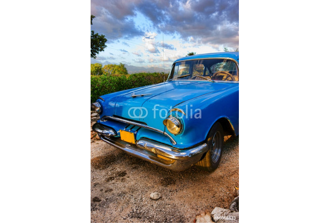 Cuadro decorativo Old blue American classic car at sunset time in mountainous and green outdoor setting in Trinidad, Cuba 64239