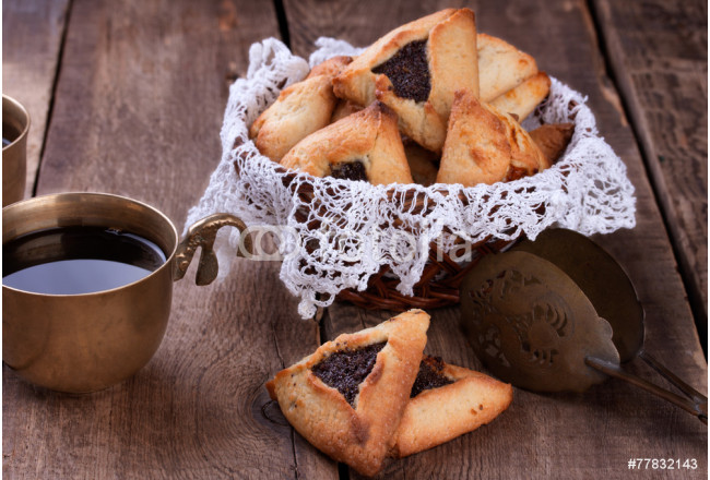 Hamantaschen cookies for Purim and coffee in ancient cup 64239