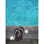 women sandals on a wooden floor with flowers near the water 64239
