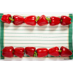 Festive frame from ripe paprika on a striped towel 64239