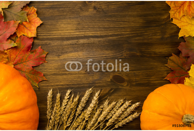 Yellow ripe pumpkin, maple leaves, red apples, wheat on wooden background. Thanksgiving, autumn, homemade. 64239