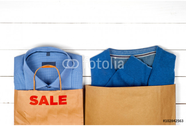 Sale with shirts on wooden background 64239