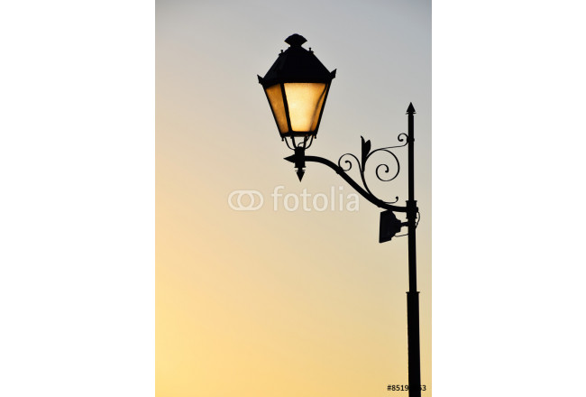 Street antique style lamp post with effect of shine from low light of sunset (vertical take) 64239