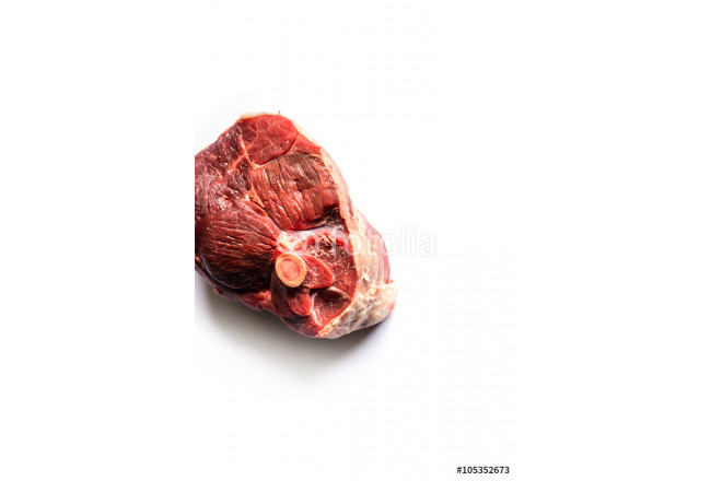 beautiful raw slice of an organic leg of lamb meat on a white background seen from above 64239
