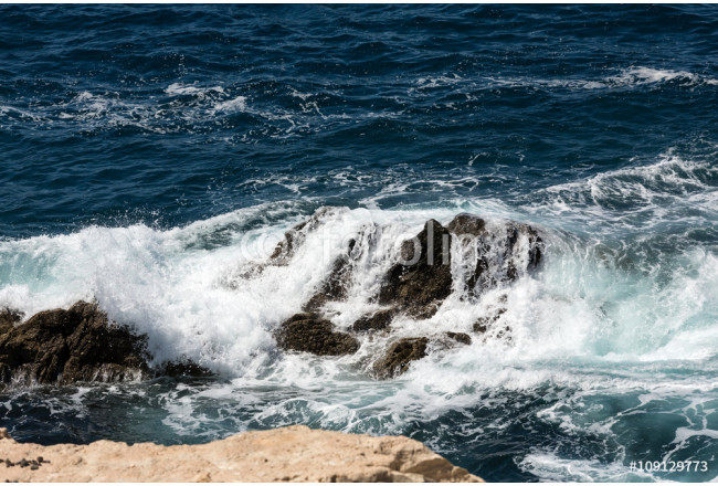 Wave splashing over a rock on Caleta Negra beach in Ajuy  on Fuerteventura. Canary Island, Spain 64239