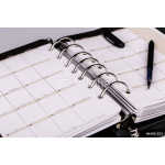 Personal organizer or planner with pen on white background 64239
