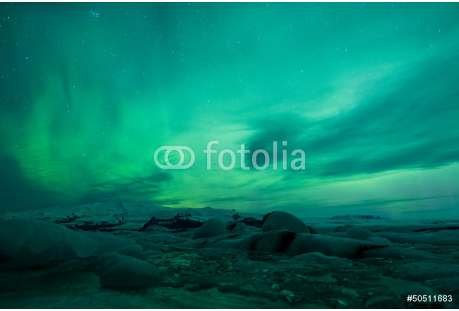 Northern lights above lagoon in Iceland 64239