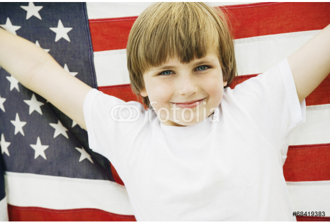 Boy holding up American flag 64239