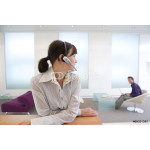 Businesswoman with headset, colleague in background 64239